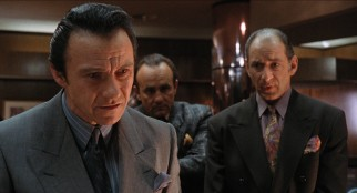Reno gangster Vince LaRocca (Harvey Keitel) and his hitmen (Robert Miranda, Richard Portnow) are the catalyst behind Deloris entering the nunhood.
