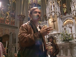 "Director Emile Ardolino directs ""Sister Act"" in a church in the making-of featurette."