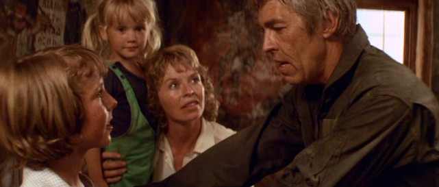 "Renegade pilot Jim McCabe (James Coburn) rescues his ex-wife (Susannah York) and children (Steven Keats, Stephany Matthews) in ""Sky Riders."""