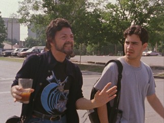 "In ""Slacker"", this rambling coffee drinker (Jerry Deloney) drops a wealth of conspiracy theory on this not terribly interested young man (Tom Pallotta) he follows."