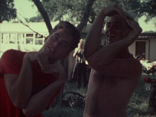 Two young men in attendance at Woodshock '85 make hearts with their arms for Richard Linklater and Lee Daniel's documentary short.