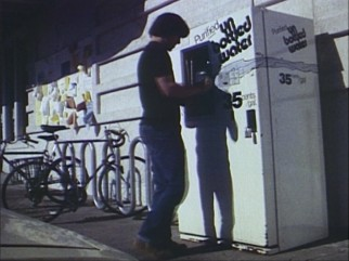 "An unnamed man fills a jug with purified bottled in the type of action you'll find in Richard Linklater's first film, ""It's Impossible to Learn to Plow by Reading Books."""