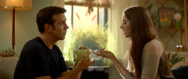 "Jake (Jason Sudeikis) gives Lainey (Alison Brie) a self-pleasure demonstration using an empty green tea bottle in ""Sleeping with Other People."""