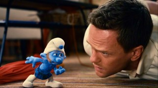 "New Scottish Smurf Gutsy talks tough to a tied-up Patrick Winslow (Neil Patrick Harris) in ""The Smurfs."""