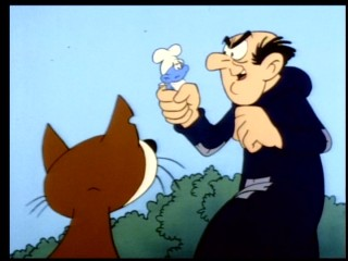 "Gargamel is glad to catch the out-of-shape Greedy Smurf in ""Gormandizing Greedy."""