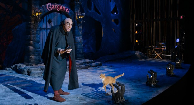 "In ""The Smurfs 2"", Gargamel (Hank Azaria) is now improbably a stage magician performing at the Paris Opera House."