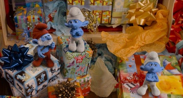 Papa Smurf and company crash Blue's birthday party, his unwrapped presents being perfect pedestals and not brightly colored enough to overshadow their blue hue.