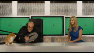 "Gargamel (Hank Azaria) appears on ""Entertainment Tonight"" with Nancy O'Dell in a deleted scene that leaves green screens unreplaced and Azrael a real, non-animated cat."