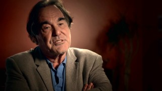 "Though his in-theater PSA may be MIA, Oliver Stone still shares his voice in the making-of featurette ""Finding the Truth."""