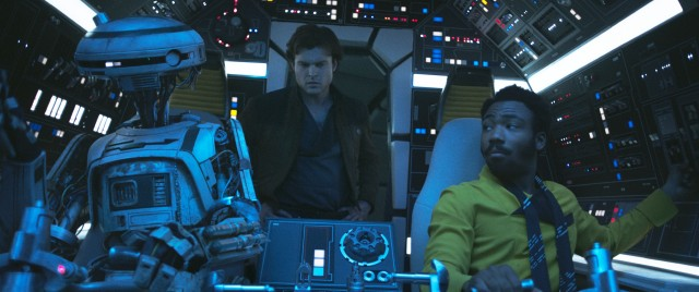"Han Solo (Alden Ehrenreich) gets his first look at the Millennium Falcon with Lando Calrissian (Donald Glover) and his droid L3-37 at the controls in ""Solo: A Star Wars Story."""