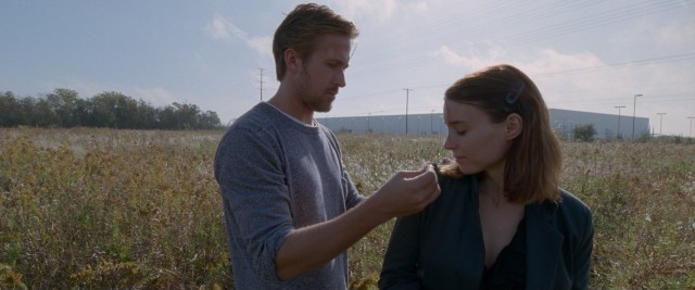 "BV (Ryan Gosling) places a caterpillar on the shoulder of Faye (Rooney Mara) in Terrence Malick's ""Song to Song."""