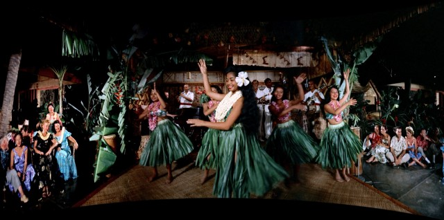 "Grass skirt dancing inevitably features in the Hawaiian segments of the 1958 Cinerama film ""South Seas Adventure."""