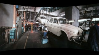 "Workers assemble and test cars in the Cinerama short ""Renault Dauphine."""