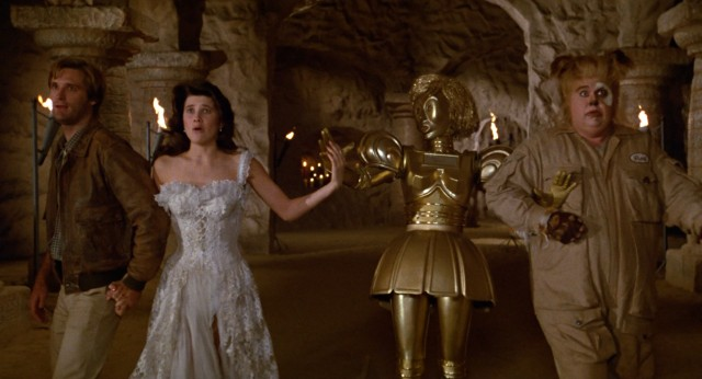 "In a sequence reminiscent of ""The Wizard of Oz"", the four heroes of ""Spaceballs"" -- Lone Starr (Bill Pullman), Princess Vespa (Daphne Zuniga), Dot Matrix, and Barf (John Candy) -- cautiously make their way to the great and powerful Yogurt."