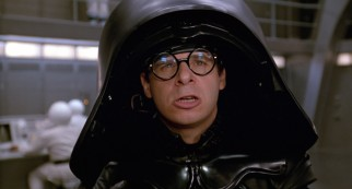 Rick Moranis plays the short but feared villain Dark Helmet.