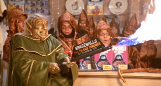 The wise golden Yogurt (Mel Brooks) demonstrates the power of merchandising with Spaceballs: The Flame Thrower.