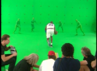 "Performers in bright green body suits, later to be replaced by the animated Monstars, come to defend Michael Jordan on the set of ""Space Jam."""
