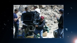 The filmmakers haul the giant IMAX camera to Arizona to shoot the Meteor Crater, as this behind-the-scenes gallery image confirms.