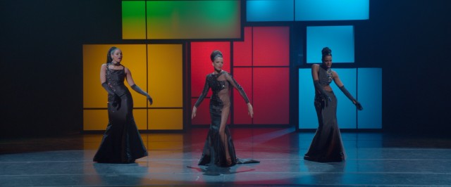 Sister and the Sisters perform in front of primary color rectangles.