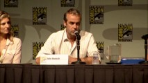John Hannah talks about the prequel series at Comic-Con 2010's Spartacus panel, while Viva Bianca looks on.