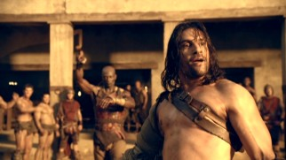 "A Crixus (Manu Bennett) messier looking than we're used to develops champion aspirations in ""Spartacus: Gods of the Arena."""