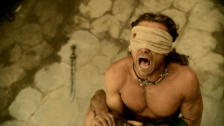 Even blindfolded, champion gladiator Gannicus (Dustin Clare) is a force to reckon with in this marketplace duel.