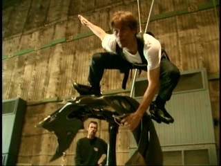 In plainclothes, Willem Dafoe tests out Gobby's glider in HBO's making-of documentary.