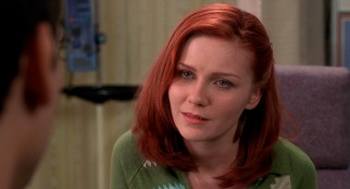 Kirsten Dunst plays Mary Jane Watson, the girl next door who functions as love interest both to Spider-Man and Peter Parker.