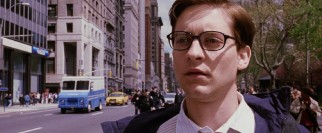 Back to being his plain old self, glasses and all, Peter Parker (Tobey Maguire) watches emergency vehicles speed by without feeling the need to suit up and be heroic.