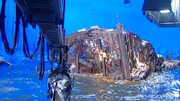 A Visual Effects Breakdown shows a miniature of Doc Ock's pier laboratory set shot on a blue screen.