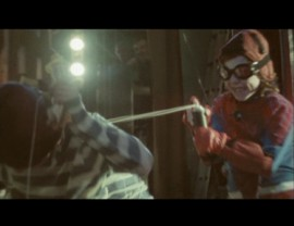 "Child Spider-Man webs (silly strings) a bad guy in Snow Patrol's fun ""Signal Fire"" music video."