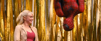 Spider-Man makes an upside-down appearance at a rally next to Gwen Stacy (Bryce Dallas Howard).