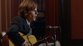"Walt Berkman (Jesse Eisenberg) performs Pink Floyd's ""Hey You"", which he passes off as an original composition."