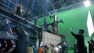 "J.J. Abrams directs his cast on an elevated set in front of green screen in ""The Secrets of 'The Force Awakens': A Cinematic Journey."""