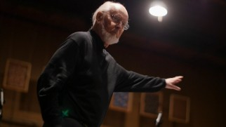 "He's back! John Williams returns for ""The Seventh Symphony"" and his composing moves look like he's using the Force to throw stormtroopers across the room."