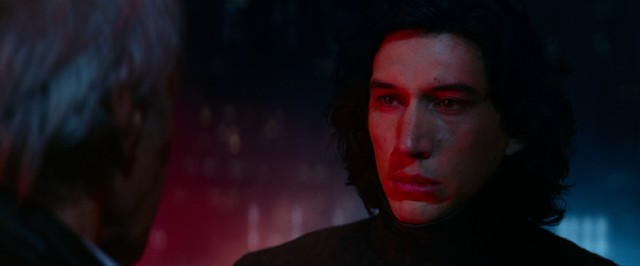Kylo Ren (Adam Driver) faces his father with a lush head of hair.