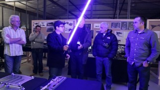"Director J.J. Abrams tests out a practical lightsaber in ""Inside the Armory."""