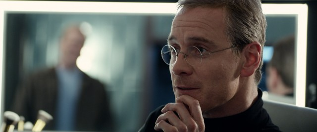 "The black turtlenecked, short-haired Steve Jobs (Michael Fassbender) we most remember emerges in the third and final act of ""Steve Jobs."""