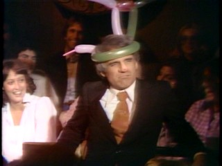 "Near the end of HBO's ""On Location"" Steve Martin ventures into the crowd wearing a balloon hat and a fake nose."