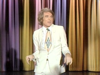 "Steve Martin does a speedy impression of a Las Vegas lounge act before an amused Johnny Carson on a 1974 episode of ""The Tonight Show."""