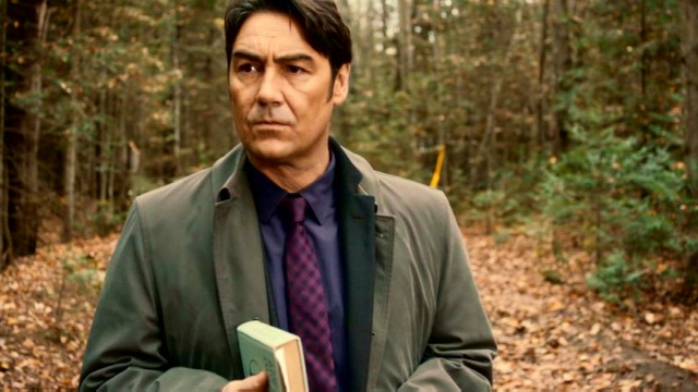 "Chief Inspector Armand Gamache (Nathaniel Parker) has a think out in the leafy woods where Jane Neal was murdered in ""Still Life: A Three Pines Mystery."""