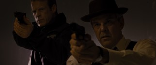 Harlend (Danny Huston), the FBI agent obsessed with nabbing Will, wears a fedora on the job alongside his partner (Mark Valley).