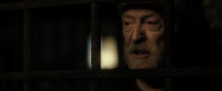 Dungeon prisoner Benjamin Salt (Michael Caine) claims that he should be running the place.