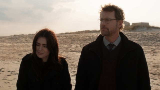 "Father (Greg Kinnear) and daughter (Lily Collins) have a chat on the beach in ""Stuck in Love."""