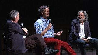 A colorfully dressed Bill Murray answers questions between Ivan Reitman and Mitch Glazer at TIFF's Bill Murray Day.