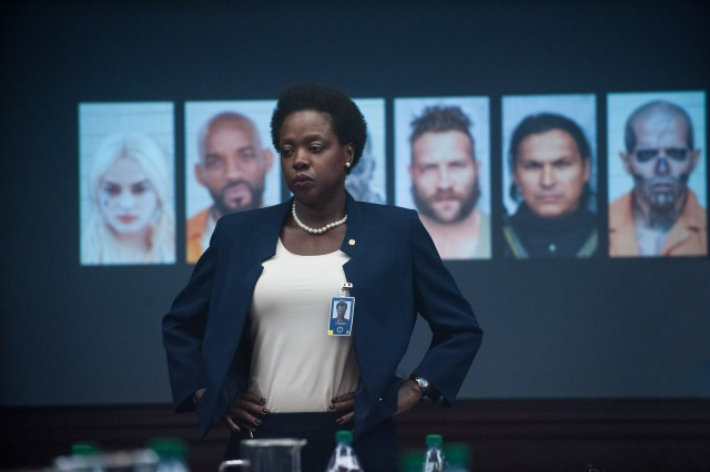 "Government official Amanda Waller (Viola Davis) pitches the dubious plan to use convicts for good in ""Suicide Squad."""