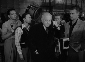 Accomplished director Cecil B. DeMille appears as himself to reluctantly meet with Norma Desmond while shooting a picture.