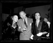 Billy Wilder stands next to his leading lady Gloria Swanson in this photo gallery image.