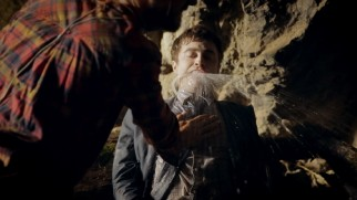 "A live Daniel Radcliffe gets fitted with a practical water spout in ""Swiss Army Man: Behind the Scenes."""