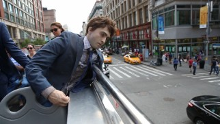 "A dead Daniel Radcliffe dummy takes in the sights of New York City from a tour bus' upper deck in ""Making Manny."""